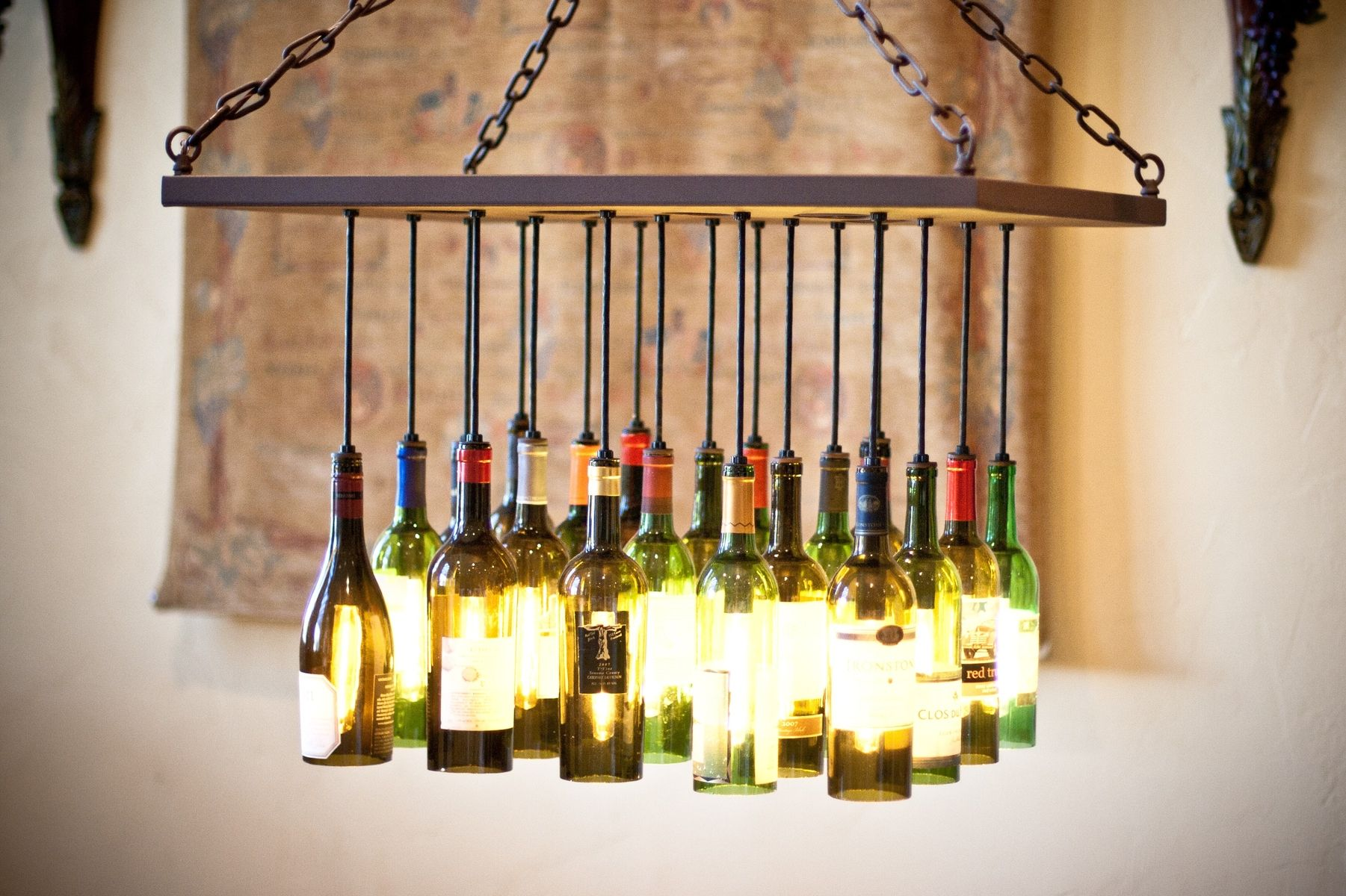 Empty wine bottles repurposed into light fittings